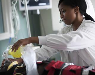 Nurse assistant working on patient