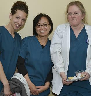 Group of nurses in scrubs at medical facility