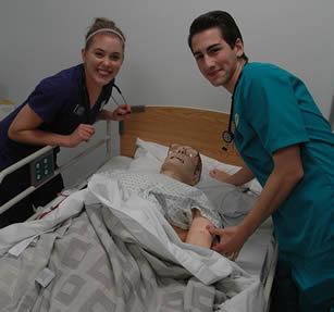 nurse-aides-practicing-on-simulator-dummy