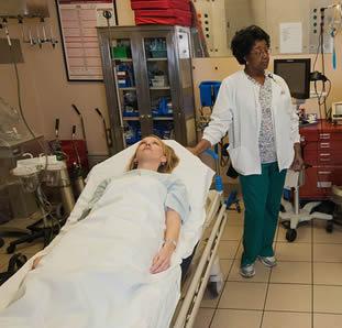 nursing assistant in exam room