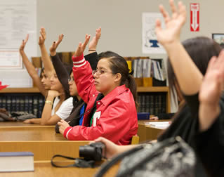 students-raising-arms-in-class