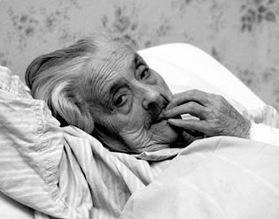 elderly-woman-in-bed-2300