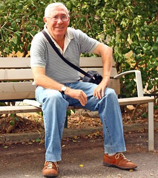 man-sitting-on-bench-994