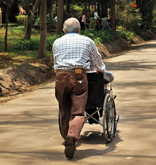 man-pushing-wheelchair-5543