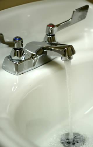 washing-hands-in-sink-0900