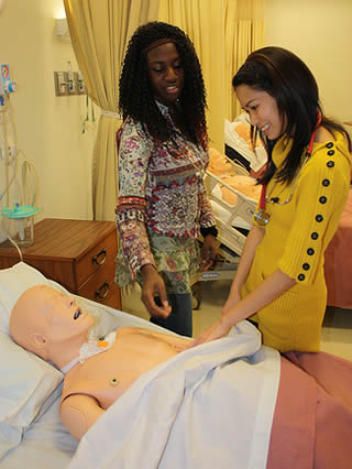 CNA workers practice skills for certification test