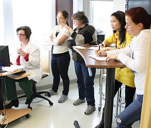 teacher-demonstrating-instruction-to-nurse-aides