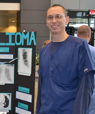 medical-student-in-scrubs-showing-presentation