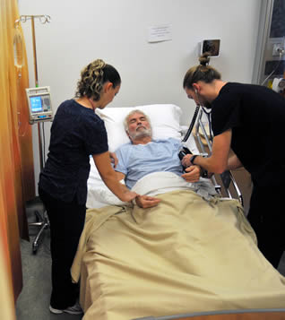 CNA's training caring for patient on the job