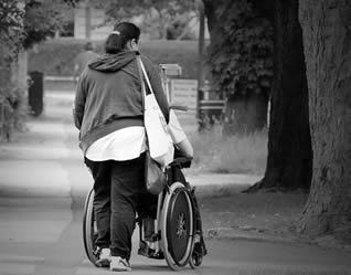 care-worker-with-elderly-in-wheelchair