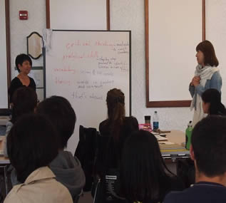 instructors speaking-to-college-class