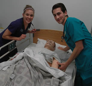 nurse-aides-practicing-on-simulator-dummy
