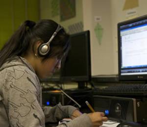 hispanic-school-girl-on-computer