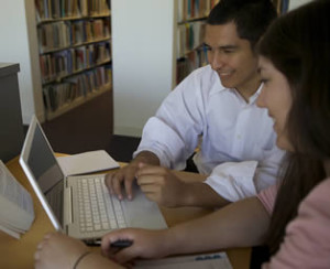 hispanic-students-working-on-laptop