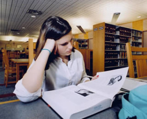 nursing-student-studying-at-library