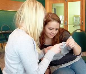 two-nursing-assistant-students-looking-at-license