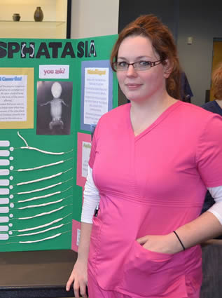 nurse-student-displaying-class-project