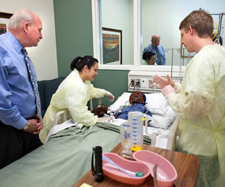 nurses-practicing-in-hospital-simulation-room