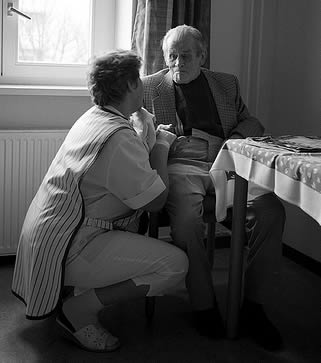 caregiver-talking-to-resident-6699