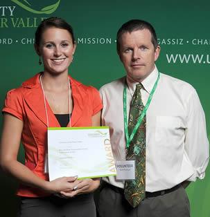 college-woman-receiving-award-8000828828222