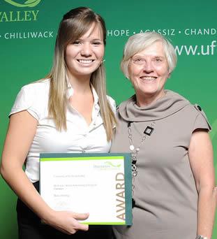 young-female-cna-receiving-award