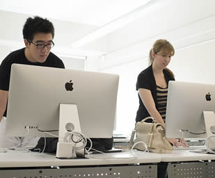 two-students-using-mac-computers