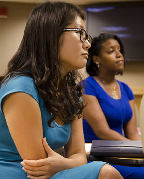 college-students-listening-to-instructor
