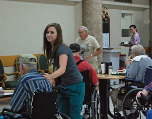 nurse-aide-helping-elderly-man