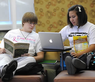 two-students-on-apple-laptop