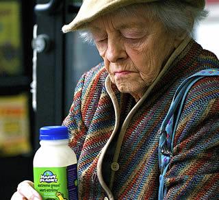 elderly-lady-with-bottle-of-juice-9992