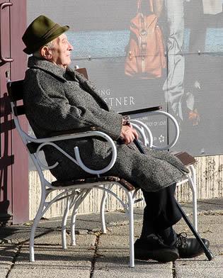 elderly-man-sitting-relaxing-9022