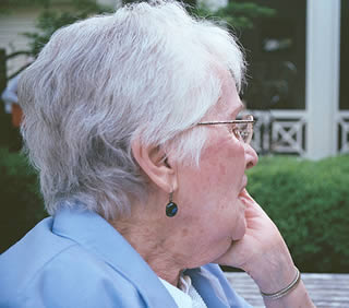elderly-woman-sitting-outside-3302