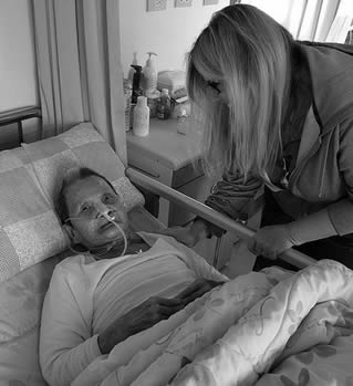 nursing-home-resident-in-bed-0111