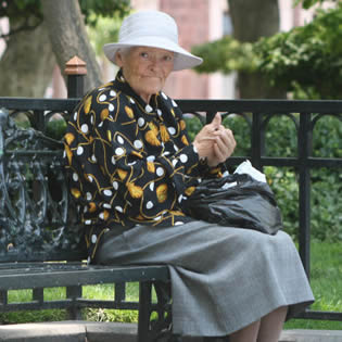 old-woman-sitting-on-bench-2201