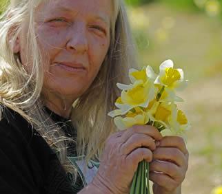 older-woman-picking-flowers-5503