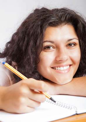 student-smiling-working-on-studies