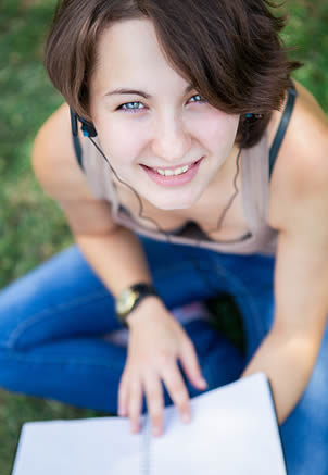 young-college-girl-studying-in-park