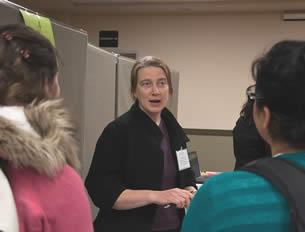nurse-aide-teacher-speaking-with-students