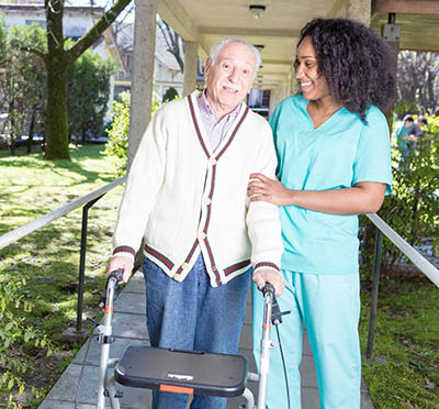 African American nursing assistant with elderly patient